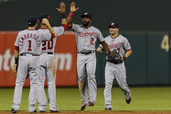 Sep 4, 2013; Philadelphia, PA, USA; Washington Nationals center fielder Denard Span (2) celebrates with shortstop Ian Desmond (20) after defeating the Philadelphia Phillies at Citizens Bank Park. The Nationals defeated the Phillies 3-2. Mandatory Credit: Howard Smith-USA TODAY Sports