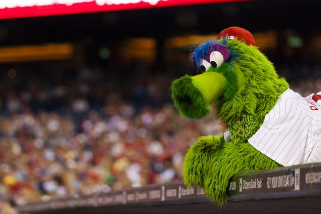 Sep 4, 2013; Philadelphia, PA, USA; The Philadelphia Phillies mascot the Phillie Phanatic watches the game from onto of the Phillies dugout during the seventh inning against the Washington Nationals at Citizens Bank Park. The Nationals defeated the Phillies 3-2. Mandatory Credit: Howard Smith-USA TODAY Sports