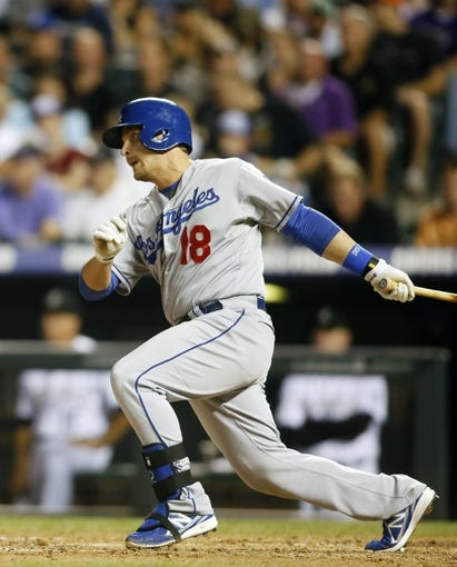 Sep 4, 2013; Denver, CO, USA; Los Angeles Dodgers pinch hitter Tim Federowcz (18) hits a single during the fifth inning against the Colorado Rockies at Coors Field. Mandatory Credit: Chris Humphreys-USA TODAY Sports