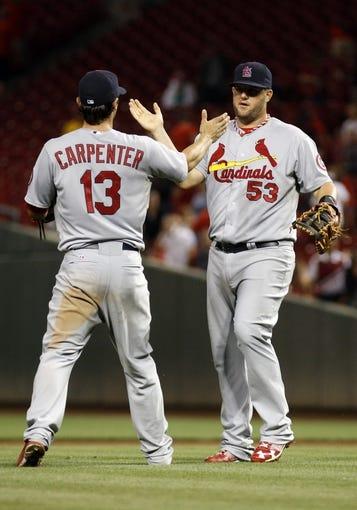 Sep 4, 2013; Cincinnati, OH, USA; St. Louis Cardinals first baseman Matt Adams (53) is congratulated by second baseman Matt Carpenter (13) after the Cardinals beat the Cincinnati Reds 5-4 in 16 innings in at Great American Ball Park. Mandatory Credit: David Kohl-USA TODAY Sports