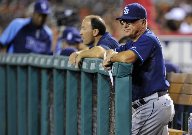 September 4, 2013; Anaheim, CA, USA; Tampa Bay Rays manager Joe Maddon (70) watches game action during the second inning against the Los Angeles Angels at Angel Stadium of Anaheim. Mandatory Credit: Gary A. Vasquez-USA TODAY Sports