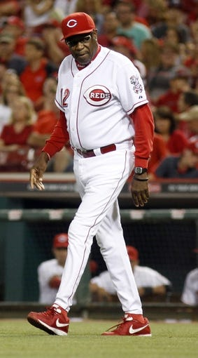 Sep 4, 2013; Cincinnati, OH, USA; Cincinnati Reds manager Dusty Baker walks to the mound during a game against the St. Louis Cardinals at Great American Ball Park. St. Louis won 5-4. Mandatory Credit: David Kohl-USA TODAY Sports