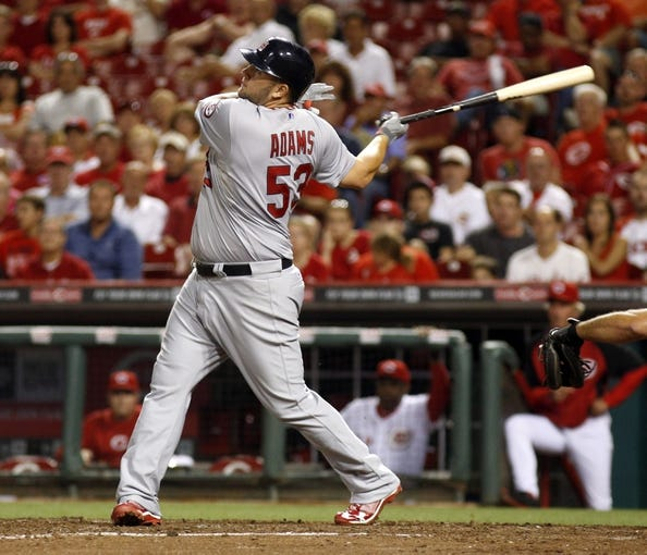 Sep 4, 2013; Cincinnati, OH, USA; St. Louis Cardinals first baseman Matt Adams hits a solo home run in the 14th inning against the Cincinnati Reds at Great American Ball Park. St. Louis won 5-4 in 16 innings. Mandatory Credit: David Kohl-USA TODAY Sports