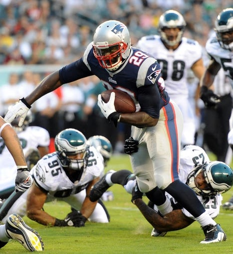 Aug 9, 2013; Philadelphia, PA, USA; New England Patriots running back LeGarrette Blount (29) runs for a touchdown against the Philadelphia Eagles during the first half of a preseason game at Lincoln Financial Field. The Patriots won 31-22. Mandatory Credit: Joe Camporeale-USA TODAY Sports