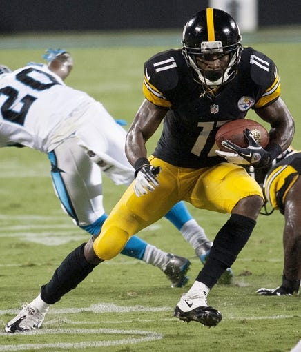 Aug 29, 2013; Charlotte, NC, USA; Pittsburgh Steelers wide receiver Markus Wheaton (11) runs after making a catch against the Carolina Panthers during the second quarter at Bank of America Stadium. Mandatory Credit: Jeremy Brevard-USA TODAY Sports
