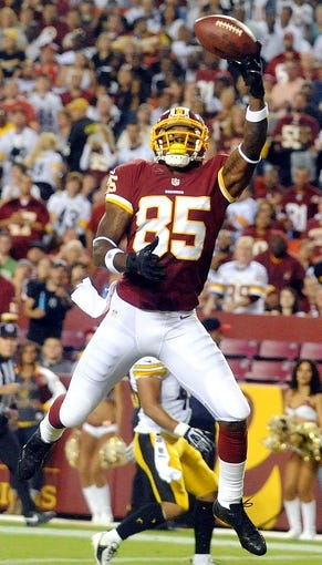 Aug 19, 2013; Landover, MD, USA; Washington Redskins wide receiver Leonard Hankerson (85) makes a touchdown reception during the first half at FedEX Field. Mandatory Credit: Brad Mills-USA TODAY Sports