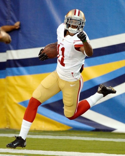 Aug 29, 2013; San Diego, CA, USA; San Francisco 49ers wide receiver Quinton Patton (11) celebrates after scoring a touchdown against the San Diego Chargers at Qualcomm Stadium. Mandatory Credit: Robert Hanashiro-USA TODAY