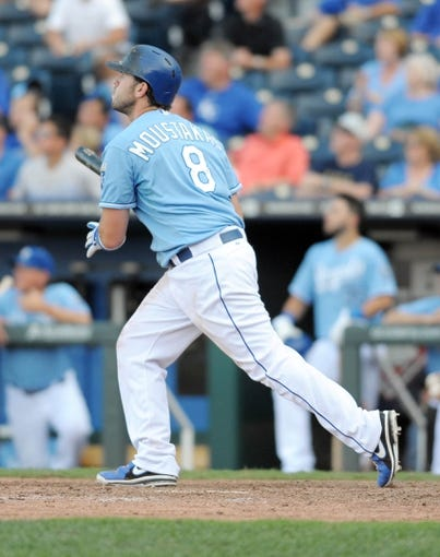 Sep 5, 2013; Kansas City, MO, USA; Kansas City Royals third baseman Mike Moustakas (8) connects for the game winning home run in the thirteenth inning of the game against the Seattle Mariners at Kauffman Stadium. The Royals won 7-6. Mandatory Credit: Denny Medley-USA TODAY Sports