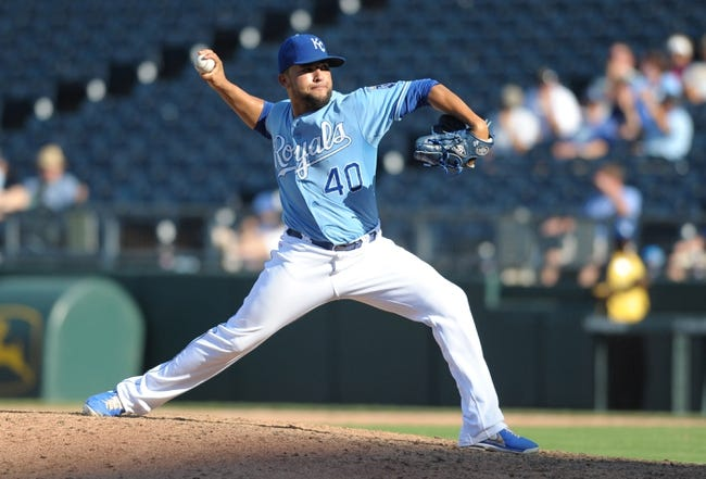 Sep 5, 2013; Kansas City, MO, USA; Kansas City Royals relief pitcher Kelvin Herrera (40) delivers a pitch in the eleventh inning of the game against the Seattle Mariners at Kauffman Stadium. The Royals won 7-6. Mandatory Credit: Denny Medley-USA TODAY Sports