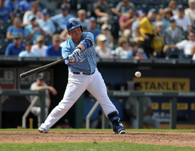 Sep 5, 2013; Kansas City, MO, USA; Kansas City Royals designated hitter Billy Butler (16) connects for a one run single in the seventh inning of the game against the Seattle Mariners at Kauffman Stadium. The Royals won 7-6. Mandatory Credit: Denny Medley-USA TODAY Sports