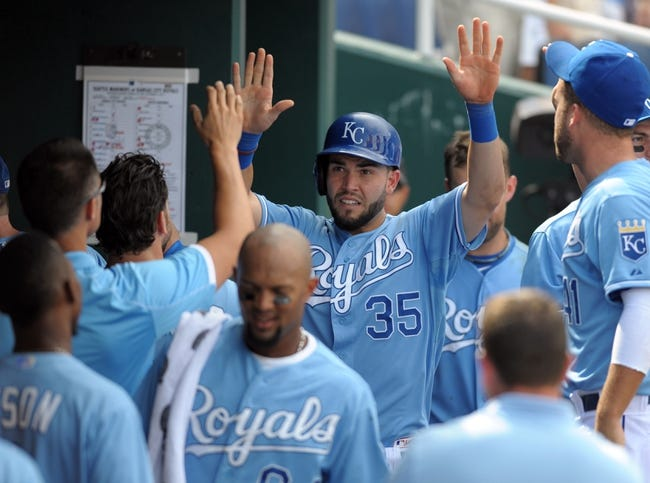 Sep 5, 2013; Kansas City, MO, USA; Kansas City Royals first baseman Eric Hosmer (35) is congratulated in the dugout after scoring in the seventh inning of the game against the Seattle Mariners at Kauffman Stadium. The Royals won 7-6. Mandatory Credit: Denny Medley-USA TODAY Sports