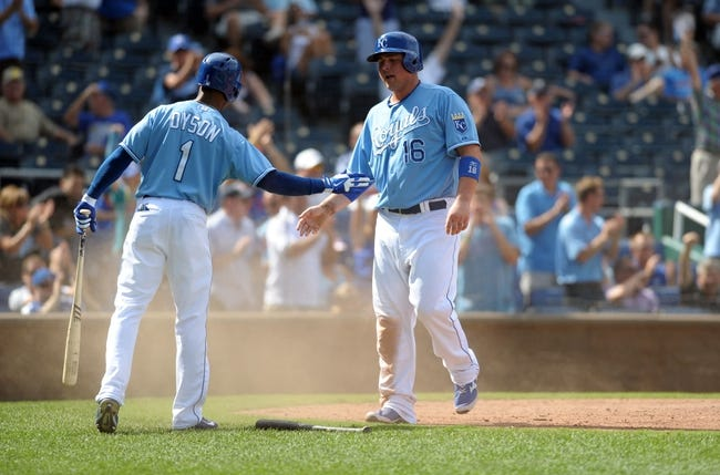Sep 5, 2013; Kansas City, MO, USA; Kansas City Royals designated hitter Billy Butler (16) is congratulated by center fielder Jarrod Dyson (1) after scoring in the seventh inning of the game against the Seattle Mariners at Kauffman Stadium. The Royals won 7-6. Mandatory Credit: Denny Medley-USA TODAY Sports