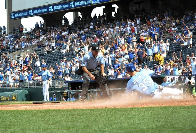 Sep 5, 2013; Kansas City, MO, USA; Kansas City Royals first baseman Eric Hosmer (35) is safe at home in the seventh inning of the game against the Seattle Mariners at Kauffman Stadium. The Royals won 7-6. Mandatory Credit: Denny Medley-USA TODAY Sports