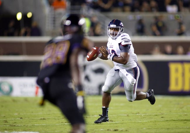 September 5, 2013; Greenville, NC, USA;  Florida Atlantic quarterback Jacquez Johnson (12) looks down field during the 2nd quarter against East Carolina at Dowdy-Ficklen Stadium. Mandatory Credit: James Guillory-USA TODAY Sports