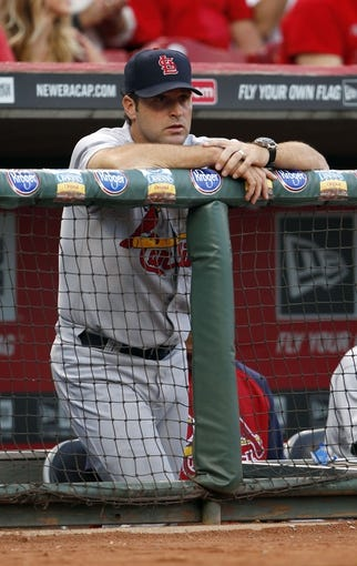 Sep 5, 2013; Cincinnati, OH, USA; St. Louis Cardinals manager Mike Matheny (22) in the dug out during the second inning against the Cincinnati Reds at Great American Ball Park. Mandatory Credit: Frank Victores-USA TODAY Sports