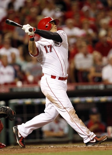 Sep 5, 2013; Cincinnati, OH, USA; Cincinnati Reds center fielder Shin-Soo Choo (17) watches a solo home run during the fourth inning against the St. Louis Cardinals at Great American Ball Park. Mandatory Credit: Frank Victores-USA TODAY Sports