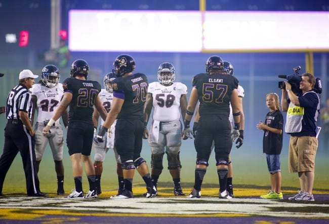 September 5, 2013; Greenville, NC, USA;  Florida Atlantic offensive linemen Mustafa Johnson (58) looks on during the coin flip against East Carolina at Dowdy-Ficklen Stadium. East Carolina Pirates defeated the Florida Atlantic Owls 31-13. Mandatory Credit: James Guillory-USA TODAY Sports
