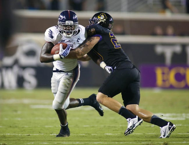 September 5, 2013; Greenville, NC, USA;  Florida Atlantic running back Jonathan Wallace (27) carries the ball against East Carolina linebacker Kyle Tudor (20) at Dowdy-Ficklen Stadium. East Carolina Pirates defeated the Florida Atlantic Owls 31-13. Mandatory Credit: James Guillory-USA TODAY Sports