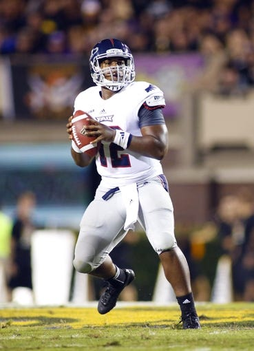 September 5, 2013; Greenville, NC, USA;  Florida Atlantic quarterback Jacquez Johnson (12) looks down the field against East Carolina at Dowdy-Ficklen Stadium. East Carolina Pirates defeated the Florida Atlantic Owls 31-13. Mandatory Credit: James Guillory-USA TODAY Sports