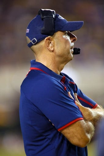 September 5, 2013; Greenville, NC, USA;  Florida Atlantic head coach Carl Pelini looks on against East Carolina at Dowdy-Ficklen Stadium. East Carolina Pirates defeated the Florida Atlantic Owls 31-13. Mandatory Credit: James Guillory-USA TODAY Sports