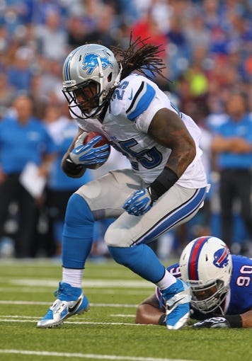 Aug 29, 2013; Orchard Park, NY, USA; Detroit Lions running back Mikel Leshoure (25) runs the ball against the Buffalo Bills at Ralph Wilson Stadium.  Mandatory Credit: Timothy T. Ludwig-USA TODAY Sports