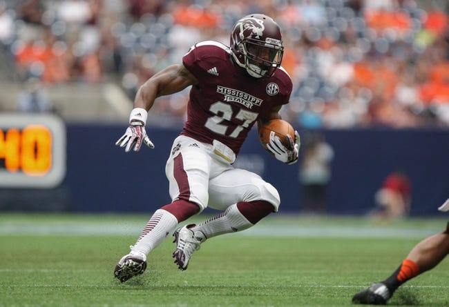 Aug 31, 2013; Houston, TX, USA; Mississippi State Bulldogs running back LaDarius Perkins (27) rushes during the first quarter against the Oklahoma State Cowboys at Reliant Stadium. Mandatory Credit: Troy Taormina-USA TODAY Sports