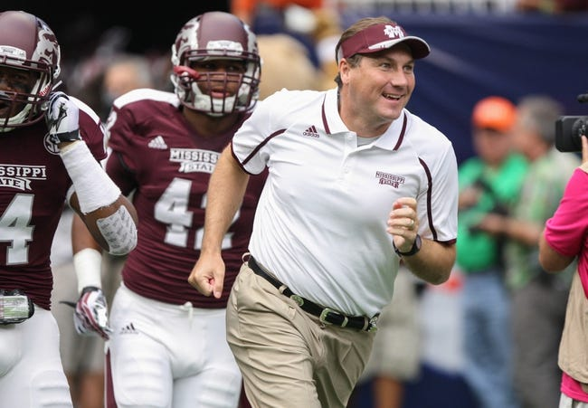 Aug 31, 2013; Houston, TX, USA; Mississippi State Bulldogs head coach Dan Mullen runs onto the field with his team before a game against the Oklahoma State Cowboys at Reliant Stadium. Mandatory Credit: Troy Taormina-USA TODAY Sports