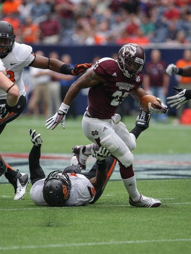 Aug 31, 2013; Houston, TX, USA; Mississippi State Bulldogs running back LaDarius Perkins (27) rushes during the second quarter against the Oklahoma State Cowboys at Reliant Stadium. Mandatory Credit: Troy Taormina-USA TODAY Sports