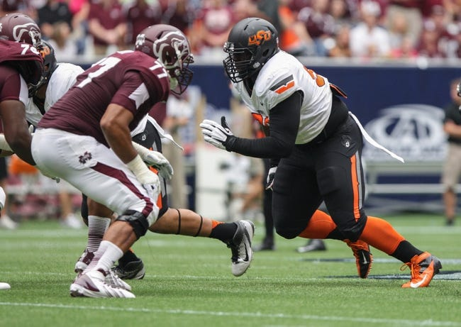 Aug 31, 2013; Houston, TX, USA; Mississippi State Bulldogs offensive linesman Charles Siddoway (77) attempts to block Oklahoma State Cowboys defensive tackle Calvin Barnett (99) during the first quarter at Reliant Stadium. Mandatory Credit: Troy Taormina-USA TODAY Sports