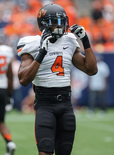 Aug 31, 2013; Houston, TX, USA; Oklahoma State Cowboys cornerback Justin Gilbert (4) warms up before a game against the Mississippi State Bulldogs at Reliant Stadium. Mandatory Credit: Troy Taormina-USA TODAY Sports