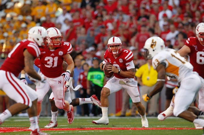 Aug 31, 2013; Lincoln, NE, USA; Nebraska Cornhuskers quarterback Taylor Martinez (3) rolls out against the Wyoming Cowboys at Memorial Stadium. Nebraska won 37-34. Mandatory Credit: Bruce Thorson-USA TODAY Sports