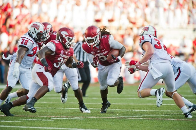 Aug 31, 2013; Fayetteville, AR, USA; Arkansas Razorback running back Alex Collins (3) carries the ball as fullback Kiero Small (36) blocks and Louisiana Ragin' Cajuns linebackers Trae Johnson (38) and Justin Anderson (34) look on during a game at Donald W. Reynolds Razorback Stadium. Arkansas defeated Louisiana 34-14. Mandatory Credit: Beth Hall-USA TODAY Sports