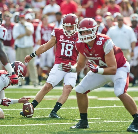 Aug 31, 2013; Fayetteville, AR, USA; Arkansas Razorback kicker Zach Hocker (18) tries for an extra point as tight end Henry Hunter (84) blocks during a game against the Louisiana Ragin' Cajuns at Donald W. Reynolds Razorback Stadium. Arkansas defeated Louisiana 34-14. Mandatory Credit: Beth Hall-USA TODAY Sports