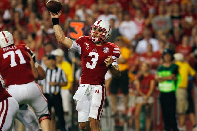 Aug 31, 2013; Lincoln, NE, USA; Nebraska Cornhuskers quarterback Taylor Martinez (3) throws against the Wyoming Cowboys in the first half at Memorial Stadium. Mandatory Credit: Bruce Thorson-USA TODAY Sports