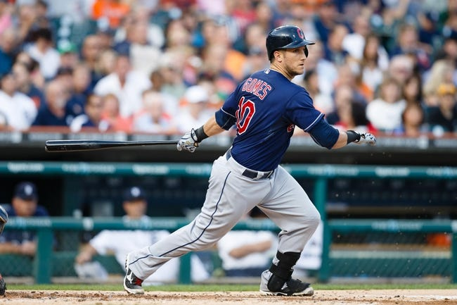 Aug 30, 2013; Detroit, MI, USA; Cleveland Indians catcher Yan Gomes (10) hits a double during the second inning against the Detroit Tigers at Comerica Park. Mandatory Credit: Rick Osentoski-USA TODAY Sports