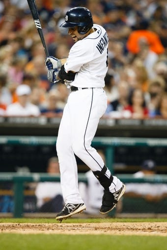Aug 30, 2013; Detroit, MI, USA; Detroit Tigers second baseman Omar Infante (4) reacts at bat against the Cleveland Indians at Comerica Park. Mandatory Credit: Rick Osentoski-USA TODAY Sports