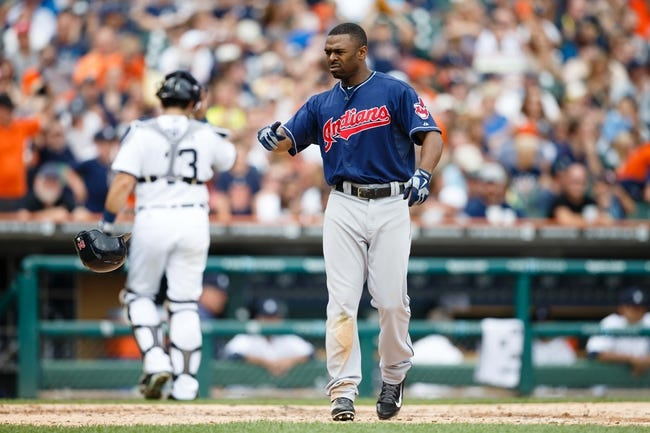 Sep 1, 2013; Detroit, MI, USA; Cleveland Indians center fielder Michael Bourn (24) tosses his helmet after striking out during the fifth inning against the Detroit Tigers at Comerica Park. Mandatory Credit: Rick Osentoski-USA TODAY Sports