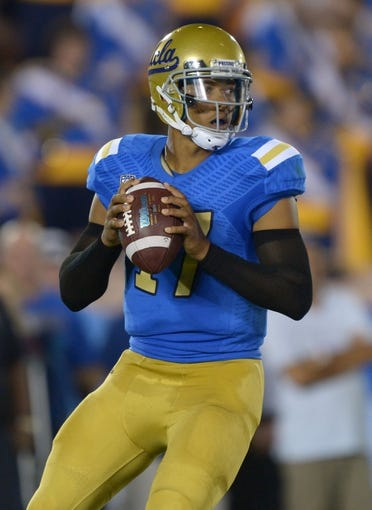 Aug 31, 2013; Pasadena, CA, USA; UCLA Bruins quarterback Brett Hundley (17) throws a pass against the Nevada Wolf Pack at the Rose Bowl. UCLA defeated Nevada 58-20. Mandatory Credit: Kirby Lee-USA TODAY Sports