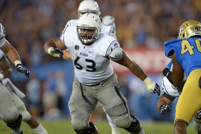 Aug 31, 2013; Pasadena, CA, USA; Nevada Wolf Pack guard Fred Lavulo (63) against the UCLA Bruins at the Rose Bowl. UCLA defeated Nevada 58-20. Mandatory Credit: Kirby Lee-USA TODAY Sports