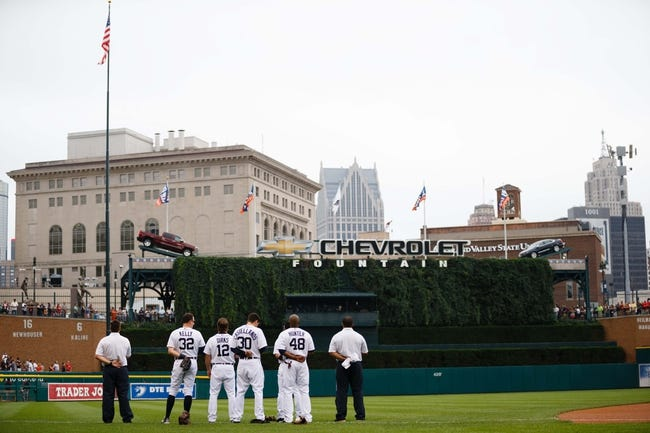 Sep 1, 2013; Detroit, MI, USA; Detroit Tigers left fielder Don Kelly (32) left fielder Andy Dirks (12) left fielder Nick Castellanos (30) and right fielder Torii Hunter (48) during the national anthem before the game against the Cleveland Indians at Comerica Park. Mandatory Credit: Rick Osentoski-USA TODAY Sports