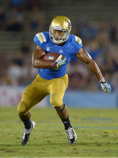 Aug 31, 2013; Pasadena, CA, USA; UCLA Bruins running back Jordon James (6) carries the ball against the Nevada Wolf Pack at the Rose Bowl. UCLA defeated Nevada 58-20. Mandatory Credit: Kirby Lee-USA TODAY Sports