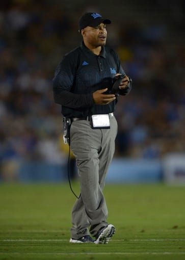 Aug 31, 2013; Pasadena, CA, USA; UCLA Bruins passing game coordinator coach Demetrice Martin during the game against the Nevada Wolf Pack at the Rose Bowl. UCLA defeated Nevada 58-20. Mandatory Credit: Kirby Lee-USA TODAY Sports