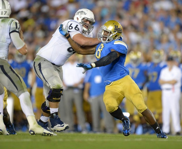 Aug 31, 2013; Pasadena, CA, USA; Nevada Wolf Pack right tackle Kyle Roberts (66) defends against UCLA Bruins linebacker Deon Hollins (8) at the Rose Bowl. UCLA defeated Nevada 58-20. Mandatory Credit: Kirby Lee-USA TODAY Sports