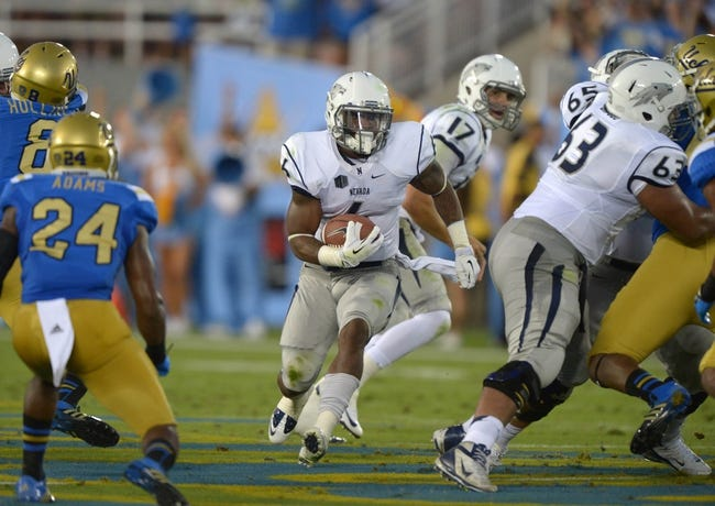 Aug 31, 2013; Pasadena, CA, USA; Nevada Wolf Pack running back Don Jackson (6) carries the ball against the UCLA Bruins at the Rose Bowl. UCLA defeated Nevada 58-20. Mandatory Credit: Kirby Lee-USA TODAY Sports