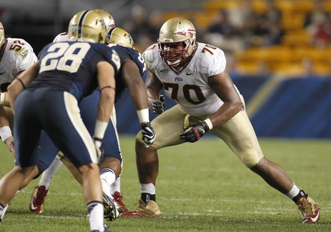 Sep 2, 2013; Pittsburgh, PA, USA; Florida State Seminoles offensive linesman Josue Matias (70) blocks at the line of scrimmage against the Pittsburgh Panthers during the third quarter at Heinz Field. The Florida State Seminoles won 41-13. Mandatory Credit: Charles LeClaire-USA TODAY Sports
