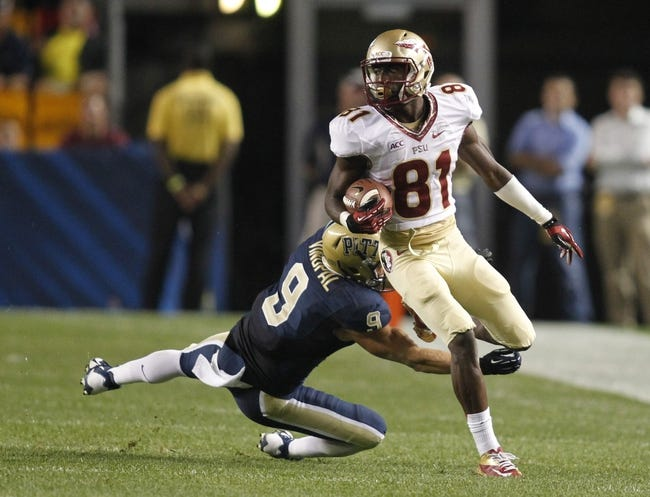 Sep 2, 2013; Pittsburgh, PA, USA; Florida State Seminoles wide receiver Kenny Shaw (81) runs after a pass reception past Pittsburgh Panthers defensive back Ray Vinopal (9) during the third quarter at Heinz Field. The Florida State Seminoles won 41-13. Mandatory Credit: Charles LeClaire-USA TODAY Sports
