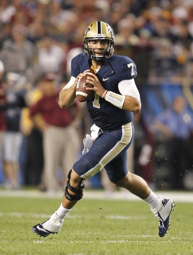 Sep 2, 2013; Pittsburgh, PA, USA; Pittsburgh Panthers quarterback Tom Savage (7) rolls out and looks to pass against the Florida State Seminoles during the third quarter at Heinz Field. The Florida State Seminoles won 41-13. Mandatory Credit: Charles LeClaire-USA TODAY Sports