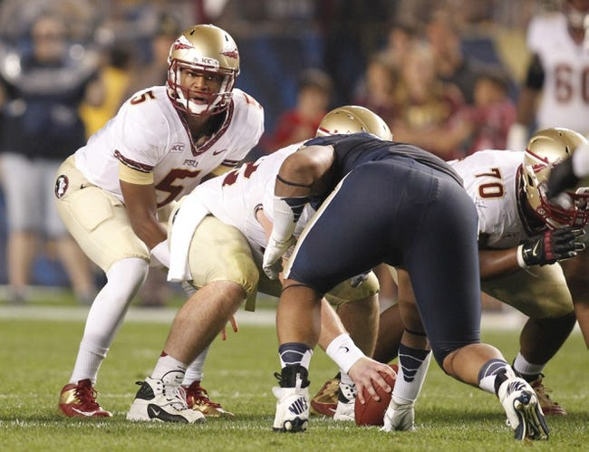 Sep 2, 2013; Pittsburgh, PA, USA; Florida State Seminoles quarterback Jameis Winston (5) under center against the Pittsburgh Panthers during the second quarter at Heinz Field. The Florida State Seminoles won 41-13. Mandatory Credit: Charles LeClaire-USA TODAY Sports