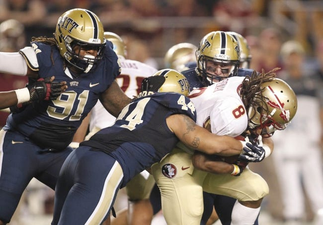 Sep 2, 2013; Pittsburgh, PA, USA; Florida State Seminoles running back Devonta Freeman (8) is tackled by Pittsburgh Panthers defensive lineman Darryl Render (91) and linebacker Shane Gordon (44) during the second quarter at Heinz Field. The Florida State Seminoles won 41-13. Mandatory Credit: Charles LeClaire-USA TODAY Sports