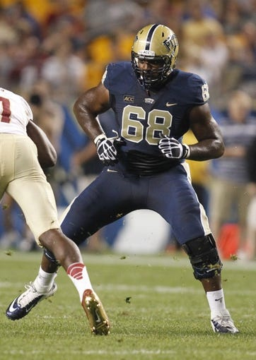 Sep 2, 2013; Pittsburgh, PA, USA; Pittsburgh Panthers offensive linesman T.J. Clemmings (68) blocks at the line of scrimmage against the Florida State Seminoles during the third quarter at Heinz Field. The Florida State Seminoles won 41-13. Mandatory Credit: Charles LeClaire-USA TODAY Sports